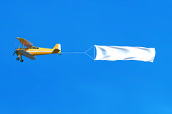 Flying airplane and banner on blue sky. 3D illustration Stock Photo