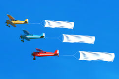 Flying airplane and banner on blue sky. 3D illustration Stock Photography