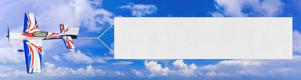 Flying airplane and banner Royalty Free Stock Images