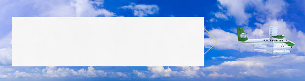 Flying airplane and banner Stock Images