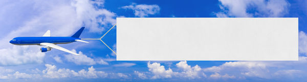Flying airplane and banner Royalty Free Stock Image