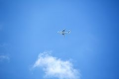 Flying airplane on the blue sky Royalty Free Stock Photos