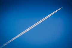 Flying airplane on the blue sky Stock Photo
