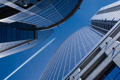 Flying airplane and office buildings. Flying airplane on a background dark blue sky in opening of office buildings Stock Photography