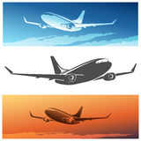Flying Airplane. Set.  silhouette and airplanes against morning or sunset sky Stock Photography