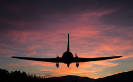 Flying airplane silhouette. Stock Photos