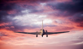 Flying airplane  silhouette. Flying airplane with landscape silhouette Stock Photo