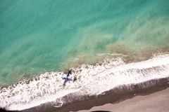 Shadow of a small plane on the shore in the bay of Kaikoura stock image