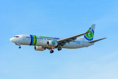 Flying Airplane Transavia PH-HZX Boeing 737-800 Transavia is landing at Schiphol airport. Stock Photo
