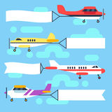 Flying airplanes and helicopters with blank banners flags vector set Royalty Free Stock Photo