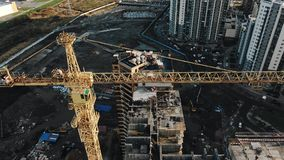 Construction crane on construction site aerial view stock video footage