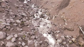 Flying along the mountain river. The stream flows through rocks stock video footage