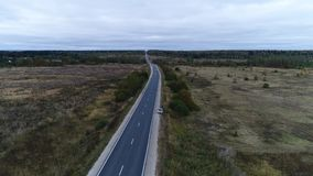 Flying along the road in the field stock footage