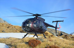 Flying in the alps. Helicopter waiting for hunters in South Westland's Southern Alps, New Zealand Stock Images