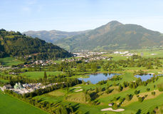 Flying in the Alps. Approach to Zell am See Airport in Salzburg with a golf course underneath Stock Photos