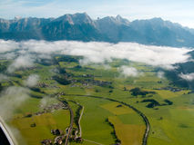 Flying in the Alps. Flying over the clouds with a nice view of the mountain range called Steinernes Meer Royalty Free Stock Images
