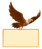 Flying american eagle holds blank banner Royalty Free Stock Images
