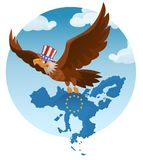 Flying American eagle holds the The European Union against the b Stock Images