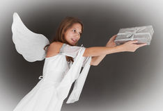 Flying angel with gift - christmas. Flying angel girl with gift on christmas Royalty Free Stock Photography