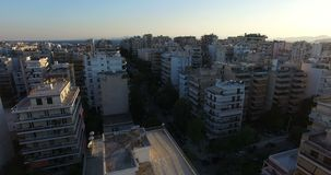 Flying among the Apartment Blocks. Of a city during the sunset stock footage