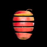 Flying apple. Sliced red apple isolated on black background. Levity fruit floating in the air. Stock Image