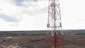 Flying around the communications tower. Aerial footage from a copter stock footage
