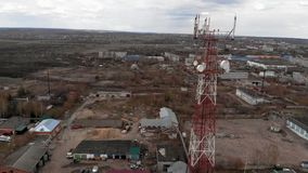 Flying around the communications tower. Aerial footage from a copter stock video footage