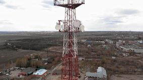 Flying around the communications tower. Aerial footage from a copter stock video