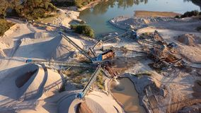 Flying around of crushed stone quarry machine. Crushed stone quarry machine at sunset view from above stock video
