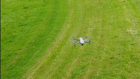 Flying around a drone and its remote pilots