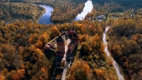 Flying around Ruins of Turaida castle on springtime, Sigulda, Latvia. Ruins of Turaida castle on springtime, Sigulda, Latvia,Turaidas pils stock video footage