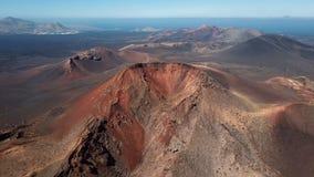 Aerial panorama of volcanic valley near Timanfaya National Park, Lanzarote. Flying around volcano near Timanfaya National Park, Lanzarote, Canary islands, Spain stock video