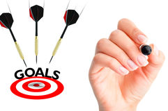 Flying arrows to a target suggesting achievement concept Royalty Free Stock Image