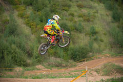 Flying athlete. MOSCOW, RUSSIA - SEPTEMBER 10, 2016: Vladimir Sychev 188 motopark Velyaminovo, class `Country Kidz`, in the 4 stage of the XSR-MOTO.RU Cross stock photo