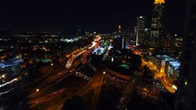 Flying between Atlanta commercial buildings. view of the lit-up city center and freeways with lots of cars in real time stock footage