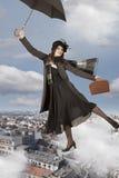 Flying away like Mary Poppins Stock Photos