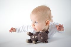 Flying baby. Baby girl with a soft toy Royalty Free Stock Photo