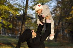 Flying baby in autumn park Stock Photos