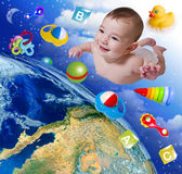 Flying baby on earth background Stock Photography