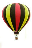 Flying Balloon. A photo of a hot air balloon in flight isolated on a white background Stock Photo