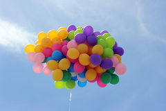 Flying balloon. A colorful flying balloon in blue sky royalty free stock photo