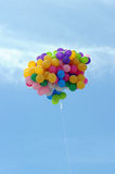 Flying balloon. A colorful flying balloon in blue sky royalty free stock photos