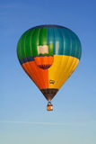 Flying balloon at sunrise Stock Photography