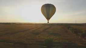 Flying a balloon at sunset