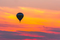 Flying balloon and sunset Stock Photo