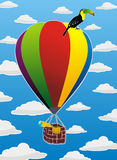 Flying balloon and toucan Royalty Free Stock Images