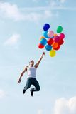 Flying with balloons Royalty Free Stock Photography