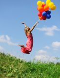 Flying with balloons Stock Images