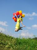Flying with balloons Stock Photos