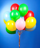 Flying balloons. On a blue background Royalty Free Stock Photography